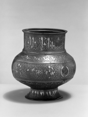 Brooklyn Museum: Jug (Mashraba) with Human-Headed Inscription and Zodiac Signs
