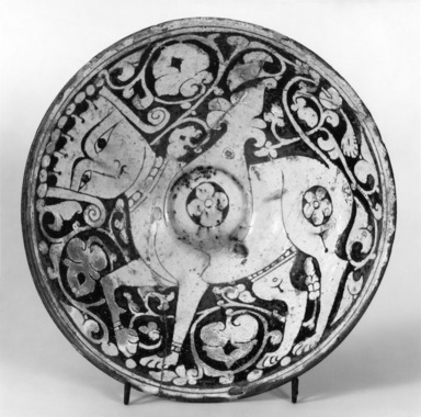 """Bowl Depicting A Human-Headed Winged Quadruped, Possibly Buraq, 11th-12th century. Ceramic, """"Garrus"""" ware; earthenware, incised on a white slip ground under a transparent brown glaze., (Overall): 2 1/2 x 7 1/8 in. (6.4 x 18.1 cm). Brooklyn Museum, Gift of the Ernest Erickson Foundation, Inc., 86.227.177. Creative Commons-BY"""