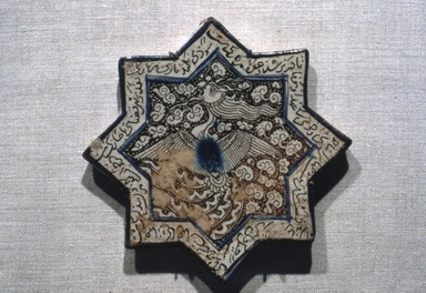 Eight-Pointed Star Tile with Simurgh (Phoenix), late 13th century. Ceramic; fritware, painted in luster and blue over an opaque white glaze, 8 x 8in. (20.3 x 20.3cm). Brooklyn Museum, Gift of the Ernest Erickson Foundation, Inc., 86.227.72. Creative Commons-BY