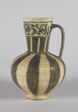 Jug, mid-12th century. Ceramic; earthenware, painted in black slip and white engobe under a transparent glaze, 6 3/4 x 4 1/2 in. (17.2 x 11.5 cm). Brooklyn Museum, Gift of the Ernest Erickson Foundation, Inc., 86.227.77. Creative Commons-BY