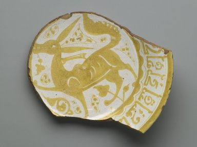 Fragment of a Plate, 11th century. Ceramic, monochrome lusterware, pink earthenware body, Diameter: 8 5/8 x 2 5/16 in. (21.9 x 5.8 cm). Brooklyn Museum, Gift of the Ernest Erickson Foundation, Inc., 86.227.82. Creative Commons-BY