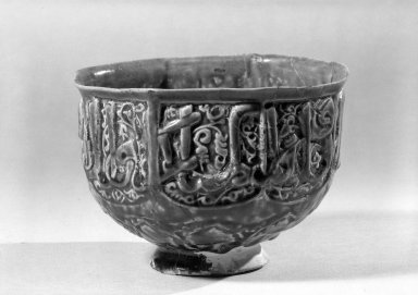 Hasan Al-Qashani. Octagonal Bowl with Inscriptions, late 12th century. Ceramic; fritware, with carved and molded decoration under a cobalt blue glaze, 4 5/16 x 6 3/8 in. (11 x 16.2 cm). Brooklyn Museum, Gift of the Ernest Erickson Foundation, Inc., 86.227.89. Creative Commons-BY
