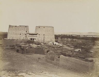 Antonio Beato (Italian and British, after 1832-1906). Edfou Pylone et Village, 19th century. Albumen silver photograph, image/sheet: 8 1/16 x 10 5/16 in. (20.4 x 26.2 cm). Brooklyn Museum, Gift of Alan Schlussel, 86.250.7