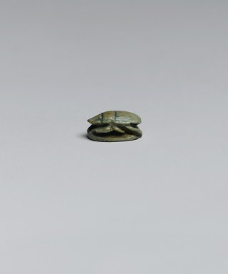 Scarab, ca. 1292-1075 B.C.E. Steatite, glazed, 1 9/16 x 1/4 x 3/8 in. (4 x 0.7 x 0.9 cm). Brooklyn Museum, Gift of Jerome A. and Mary Jane Straka, 86.252.10. Creative Commons-BY