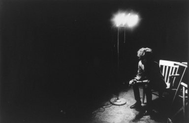 Nat Finkelstein (American, 1933-2009). Dylan Under Spot Bob Dylan, 1966. Gelatin silver photograph, image: 22 3/4 x 15 in. (57.8 x 38.1 cm). Brooklyn Museum, Gift of the son of Abe and Esther Finkelstein, a Brooklyn cab driver and his wife, 87.150.1. © Estate of Nat Finkelstein