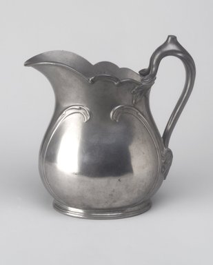 Reed & Barton (American, 1840-present). Pitcher, ca. 1908. Pewter, 8 1/4 x 8 x 4 1/2 in. (21 x 20.3 x 11.4 cm). Brooklyn Museum, Gift of Emma and Jay Lewis, 87.174. Creative Commons-BY