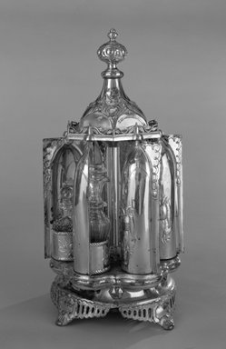 R. Gleason & Sons. Magic Dinner Caster, Patented December 1, 1857. Silverplate, colorless glass, 17 x 9 1/8 x 9 1/8 in. (43.2 x 23.2 x 23.2 cm). Brooklyn Museum, H. Randolph Lever Fund, 87.175.1-.7a-b. Creative Commons-BY