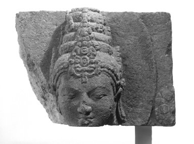 Head of a Deity, 9th-10th century. Volcanic stone, 9 7/8 x 5 7/8 x 3 1/8 in. (25.1 x 14.9 x 7.9 cm). Brooklyn Museum, Gift of Georgia and Michael de Havenon, 87.188.10. Creative Commons-BY