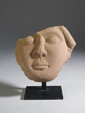 Fragment of a Face, 185-72 B.C.E. Sandstone relief, 6 1/8 x 6 11/16 x 2 3/16 in. (15.5 x 17 x 5.5 cm). Brooklyn Museum, Gift of Georgia and Michael de Havenon, 87.188.11. Creative Commons-BY