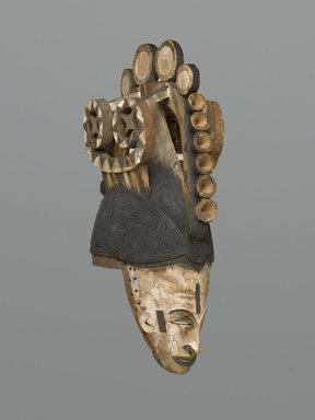 Igbo. Maiden Spirit Helmet Mask (Agbogho Mmwo), early 20th century. Wood, pigment, string, 19 3/4 x 5 3/4 x 12 in. (50.2 x 14.6 x 30.5 cm). Brooklyn Museum, Gift of Marc and Ruth Franklin in memory of Lillian S. Korzenik, 87.215. Creative Commons-BY
