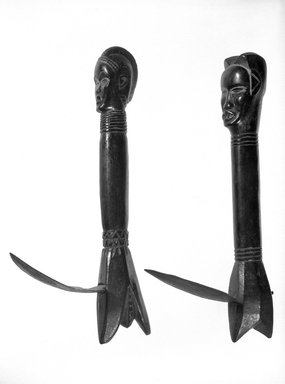 Feia Tomekpa (Dan, flourished 1940s-early 1950s). Ceremonial Hoe, 20th century. Wood, iron, 14 1/8 x 2 1/4 x 4 1/16 in. (35.9 x 5.7 x 10.3 cm). Brooklyn Museum, Gift of Mr. and Mrs. Brian S. Leyden, 87.216.1. Creative Commons-BY