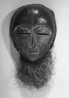 Ngbaka. Mask, 20th century. Wood, raffia fiber and cloth, 16 1/2 x 8 3/4 x 4 1/2 in. (42.0 x 22.2 x 11.5 cm). Brooklyn Museum, Gift of Dr. and Mrs. Abbott A. Lippman, 87.217.1. Creative Commons-BY