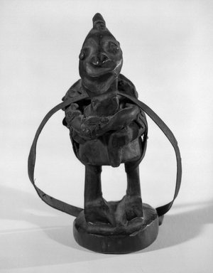Yoruba. Figure Holding a Flute, late 19th or early 20th century. Wood, leather, 5 1/2 x 2 x 2 1/4 in. (14 x 5.1 x 5.7 cm). Brooklyn Museum, Gift of Marcia and John Friede and Mrs. Melville W. Hall, 87.218.115. Creative Commons-BY