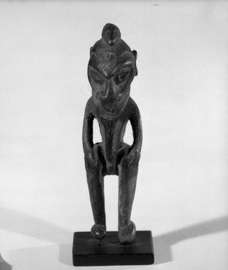 Figure. Wood, 4 3/4 x 1 3/8 x 1 3/8 in. (12.1 x 3.5 x 3.5 cm). Brooklyn Museum, Gift of Marcia and John Friede and Mrs. Melville W. Hall, 87.218.36. Creative Commons-BY