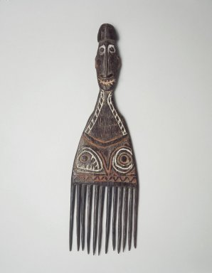 Comb Surmounted by a Head. Wood, pigment, 12 x 3 1/2 x 3/4 in. (30.5 x 8.9 x 1.9 cm). Brooklyn Museum, Gift of Marcia and John Friede and Mrs. Melville W. Hall, 87.218.54. Creative Commons-BY
