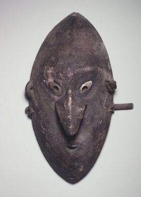 Mask, late 19th-early 20th century. Wood, clay, shell, pigment, bamboo, plant fiber, 19 1/4 x 11 1/4 x 6 in.  (48.9 x 28.6 x 15.2 cm). Brooklyn Museum, Gift of Marcia and John Friede and Mrs. Melville W. Hall, 87.218.62. Creative Commons-BY