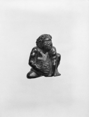 Netsuke in the Form of a Korumbo (South Sea Islander), 19th century. Carved ebony and coral, 1 1/2 x 1 1/4 in. (3.8 x 3.2 cm). Brooklyn Museum, Gift of Maybelle M. Dore, 87.228.1. Creative Commons-BY