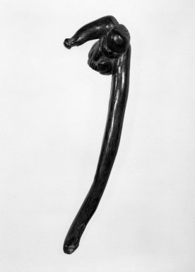 Sashi (Elongated) Netsuke in Form of  a Gibbon, 19th century. Carved buffalo horn, 1 1/2 x 5 1/2 in. (3.8 x 14 cm). Brooklyn Museum, Gift of Maybelle M. Dore, 87.228.7. Creative Commons-BY
