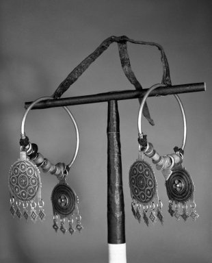 Pair of Earrings, late 19th century. Silver, beads, coins, cloisonne enamel, 5 1/2 x 5 in. (14 x 12.7 cm). Brooklyn Museum, Gift of Dr. Virgil H. Bird, 88.193.2a-b. Creative Commons-BY