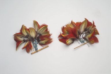 Shuar. Pair of Ear Ornaments, first half of the 20th century. Feathers, bamboo, glass beads, fiber, 4 1/2 x 3 1/2 x 4 in. (11.4 x 8.9 x 10.2 cm). Brooklyn Museum, Anonymous gift, 88.89.12a-b. Creative Commons-BY
