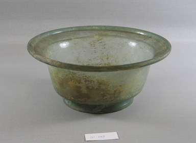 Roman. Bowl of Molded Green Glass, 1st - 5th century C.E. Glass, 3 1/2 x Diam. 8 1/4 in. (8.9 x 20.9 cm). Brooklyn Museum, Gift of Robert B. Woodward, 01.105. Creative Commons-BY