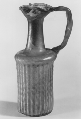 Roman. Molded Jug, 4th century C.E. Glass, 6 11/16 x 2 11/16 x 3 3/4 in. (17 x 6.9 x 9.5 cm). Brooklyn Museum, Gift of Robert B. Woodward, 01.259. Creative Commons-BY