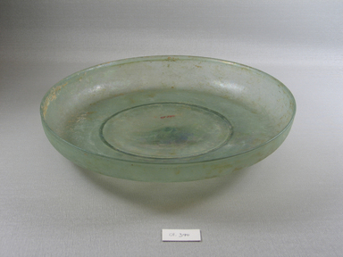 Roman. Shallow Bowl of Molded Green Glass, Late 4th century C.E. Glass, 1 15/16 x Diam. 10 5/8 in. (5 x 27 cm)  . Brooklyn Museum, Gift of Robert B. Woodward, 01.390. Creative Commons-BY