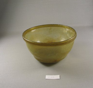 Roman. Bowl of Molded Glass, 1st - 5th century C.E. Glass, 4 1/16 x greatest diam. 7 3/8 in. (10.3 x 18.8 cm). Brooklyn Museum, Gift of Robert B. Woodward, 01.407. Creative Commons-BY