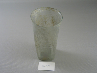 Roman. Tumbler of Blown Glass, 3rd - 4th century C.E. Glass, 4 9/16 x Diam. 2 3/8 in. (11.6 x 6 cm). Brooklyn Museum, Gift of Robert B. Woodward, 01.44. Creative Commons-BY