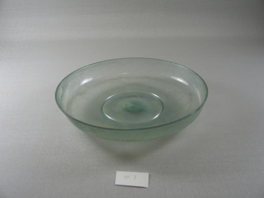 Roman. Bowl of Plain Blown Glass, Late 4th century C.E. Glass, 1 1/4 x 8 3/8 in. (3.1 x 21.2 cm). Brooklyn Museum, Gift of Robert B. Woodward, 01.7. Creative Commons-BY