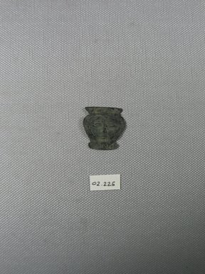 Head of Hathor. Sheet copper?, 1 x 1 in. (2.6 x 2.5 cm). Brooklyn Museum, Gift of the Egypt Exploration Fund, 02.225. Creative Commons-BY