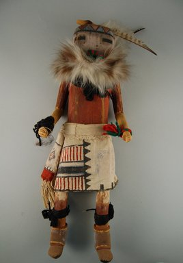 She-we-na (Zuni Pueblo) (Native American). Kachina Doll (Apache), late 19th century. Feathers, wood, pigment, cloth, yarn, fur, nails, hide, string, 6 7/16 x 3 1/8 x 18in. (16.4 x 7.9 x 45.7cm). Brooklyn Museum, Museum Expedition 1903, Museum Collection Fund, 03.325.4611. Creative Commons-BY
