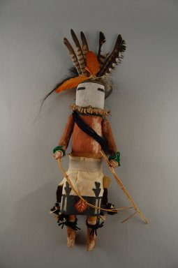 She-we-na (Zuni Pueblo) (Native American). Kachina Doll (Zum Tsehapa), late 19th century. Feathers, yarn, wood, cloth, string, hair, pigment, nails, fiber, feathers, 11 13/16 x 2 3/8 x 4 3/16 in.  (30.0 x 6.1 x 10.6 cm). Brooklyn Museum, Museum Expedition 1903, Museum Collection Fund, 03.325.4641. Creative Commons-BY