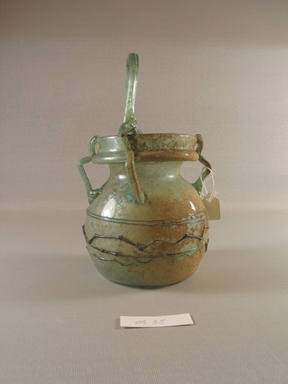 Roman. Basket-shaped Vase of Blown Green Glass. Glass, 7 1/16 x 4 1/16 in. (18 x 10.3 cm). Brooklyn Museum, Gift of Robert B. Woodward, 03.35. Creative Commons-BY