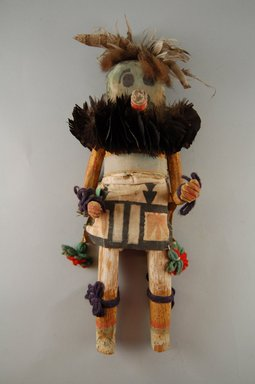 Mau-i (She-we-na (Zuni Pueblo), Native American). Kachina Doll (Thlecheche), late 19th-early 20th century. Feathers, buffalo fur, wood, pigment, cotton, yarn, 13 x 4 1/2 x 4 in. (33 x 11.4 x 10.2 cm). Brooklyn Museum, Museum Expedition 1904, Museum Collection Fund, 04.297.5333. Creative Commons-BY