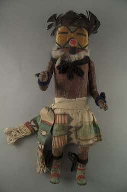 Mau-i (She-we-na (Zuni Pueblo), Native American). Kachina Doll (Panek Thluptse), late 19th-early 20th century. Wood, pigment, feathers, fur, cotton, 14 15/16 x 5 7/16 x 3 7/8in. (38 x 13.8 x 9.8cm). Brooklyn Museum, Museum Expedition 1904, Museum Collection Fund, 04.297.5334. Creative Commons-BY