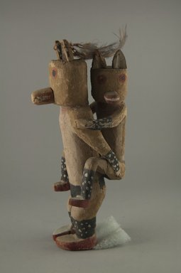 Hopi Pueblo (Native American). Kachina Doll (Kwawuu [Wolf]), late 19th century. Wood, pigment, cotton, feather, 11 1/4 x 3 1/4 in. (28.6 x 8.3 cm). Brooklyn Museum, Museum Expedition 1904, Museum Collection Fund, 04.297.5596. Creative Commons-BY