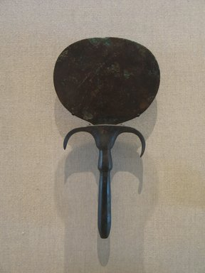 Mirror with Handle in the Form of Papyrus Column, with Large Umbel, ca. 2040-1801 B.C.E. Bronze, 9 1/4 x 4 15/16 in. (23.5 x 12.5 cm). Brooklyn Museum, Charles Edwin Wilbour Fund, 05.321. Creative Commons-BY