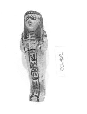 Small White Glazed Faience Ushabti of a Lady with Inscription in Brown, ca. 1190-712 B.C.E. Faience, glazed, 4 5/8 x 1 9/16 x 1 1/8 in. (11.8 x 3.9 x 2.8 cm). Brooklyn Museum, Musum Collection Fund, 05.402. Creative Commons-BY