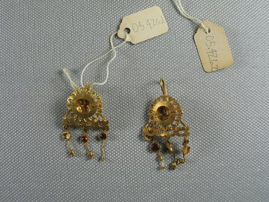 Pair of Earrings, 3rd century C.E. Gold, 05.426.1: 7/8 x (Diam.) 1 7/16 in. (2.2 x 3.6 cm). Brooklyn Museum, Ella C. Woodward Memorial Fund, 05.426.1-.2. Creative Commons-BY