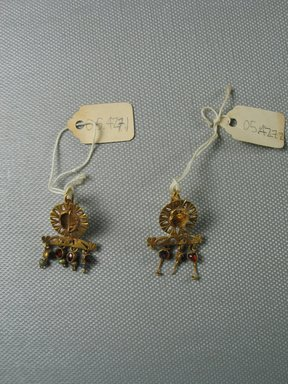 Pair of Earrings, 3rd century C.E. Gold, glass, garnet, 9/16 x 1 15/16 in. (1.4 x 5 cm). Brooklyn Museum, Ella C. Woodward Memorial Fund, 05.427.1-.2. Creative Commons-BY