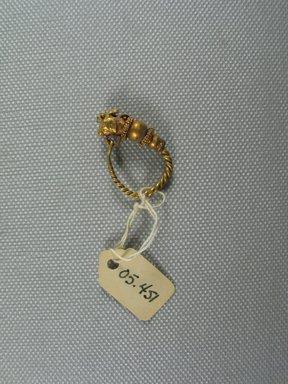Greek. Single Earring, 2nd-1st century B.C.E. Gold, 1 1/16 x Diam. of loop 3/4 in. (2.7 x 1.9 cm). Brooklyn Museum, Ella C. Woodward Memorial Fund, 05.451. Creative Commons-BY