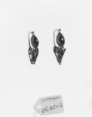 Earrings, 3rd century C.E. Gold, garnet, 1 in. (2.6 cm). Brooklyn Museum, Ella C. Woodward Memorial Fund, 05.467.1-.2. Creative Commons-BY