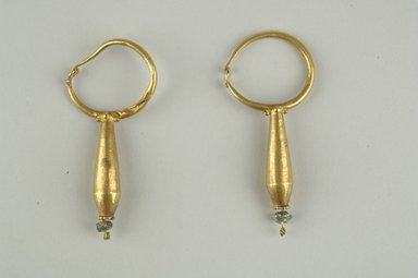Coptic. Earrings, 6th-7th century C.E. Gold, glass, Average dimensions: 2 1/2 x 1 1/16 in. (6.3 x 2.7 cm). Brooklyn Museum, Ella C. Woodward Memorial Fund, 05.472.1-.2. Creative Commons-BY