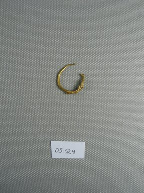 Earring, 2nd century B.C.E. Gold, Greatest Diam. 5/8 in. (1.6 cm). Brooklyn Museum, Ella C. Woodward Memorial Fund, 05.524. Creative Commons-BY