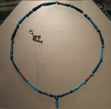Tear-drop Beads and Uraeus-amulet, ca. 1390-1292 B.C.E. Glass, At greatest extension: 21 in. (53.3 cm). Brooklyn Museum, Charles Edwin Wilbour Fund, 05.577. Creative Commons-BY