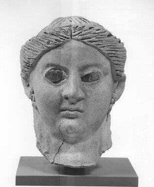 Graeco-Egyptian. Mask of a Woman, ca. 150 C.E.-175 C.E. Plaster, glass, 5 11/16 x 5 3/16 x 9 5/8 in. (14.5 x 13.2 x 24.5 cm). Brooklyn Museum, Museum Collection Fund, 06.286. Creative Commons-BY