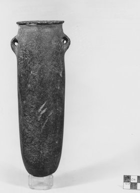 Tubular Hanging Vase. Basalt or arkose, 8 7/8 x Greatest diam. 3 3/8 in. (22.5 x 8.5 cm). Brooklyn Museum, Charles Edwin Wilbour Fund, 07.447.188. Creative Commons-BY