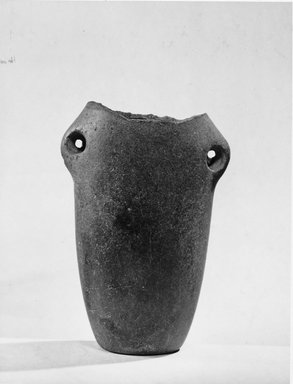Tubular Hanging Vase, ca. 3500 B.C.E. - 3300 B.C.E. Basalt or arkose, 5 1/16 x 3 3/8 in. (12.8 x 8.5 cm). Brooklyn Museum, Charles Edwin Wilbour Fund, 07.447.189. Creative Commons-BY