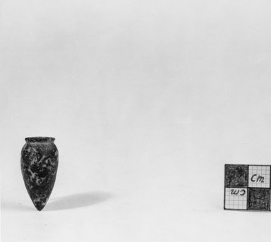 Miniature Vase. Diorite, 1 1/4 x Diam. 11/16 in. (3.2 x 1.7 cm). Brooklyn Museum, Charles Edwin Wilbour Fund, 07.447.202. Creative Commons-BY